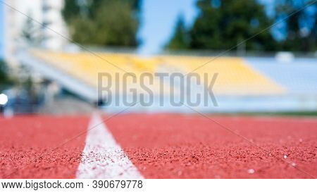 Running Track In Selective Focus. Finish Line. Health And Sport. Path For Runners. Racetrack On Outd