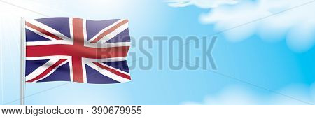 Uk Flag Waving On A Blue Sky Background. Patriotic Vector Banner Design, With The National Flag Of T