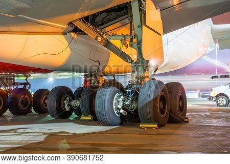 Group Of Main Landing Gear Of A Wide-body Aircraft Under The Wing And Fuselage