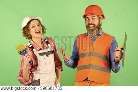 Pick Color. Diy Repair. Construction Workers. Home Renovation. Cheerful Couple Renovating House. Wom