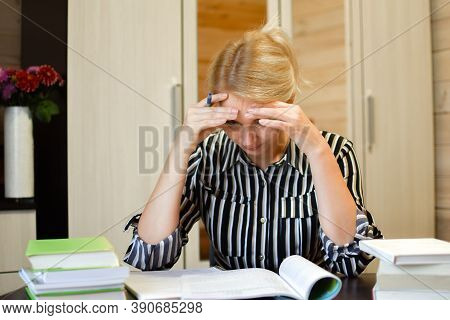 Business Woman Thinks Over Work At Table At Laptop, Solving Difficult Problem. Thinking About An Ide