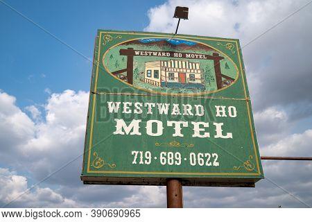 Cripple Creek, Colorado - September 16, 2020: Sign For The Abandoned Westward Ho Motel Against A Clo