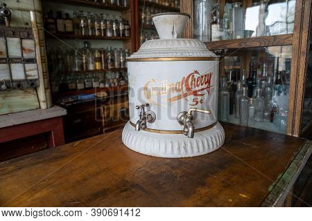 South Park City, Colorado - September 16, 2020: Antique Cardinal Cherry Soda Fountain Dispenser On T
