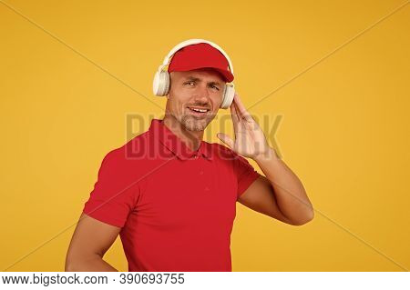 Enjoying Quality Sound On Go. Handsome Man Listen To Sound Track. Guy Wear Earphones Playing Electro