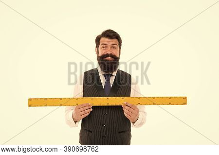 Learning Metric System. School Teacher. Size Really Matters. Man Bearded Hipster Holding Ruler. Meas