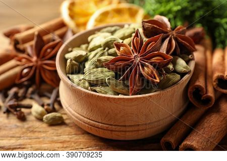 Dry Anise Stars, Cardamon And Cinnamon On Wooden Table, Closeup. Mulled Wine Ingredients