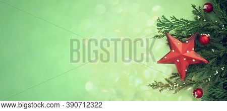 Christmas Red Star Ornament And Natural Decoration On Green Background With Copy Space. Christmas, B