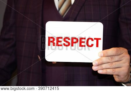 Businessman Holding A Card With Text Respect