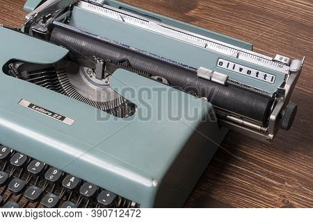 Udine, Italy. October 20, 2020. An Old Olivetti Typewriter, Model Letter 22 On A Wooden Table