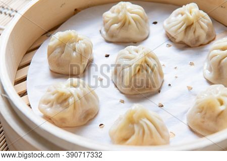 Steamed Xiaolongbao Served In A Traditional Steaming Basket (.close Up)