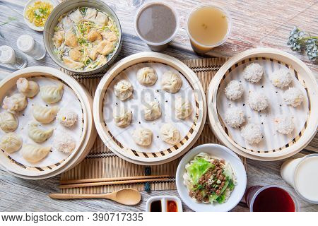 Steamed Xiaolongbao And Steamed Dumplings Served In A Traditional Steaming Basket