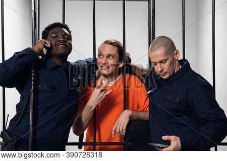 Warders In A High-security Prison Mock A Prisoner In A Cell, Take Photos With Him On A Smartphone