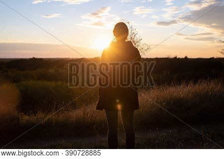 Beautiful Woman In Meadow In Nature. People In Nature Lifestyle. Woman In Meadow In Sunset. Nature L
