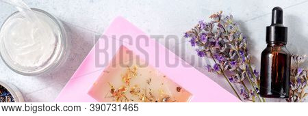 Handmade Soap Ingredients Panorama. Glycerin, Lavender Flowers, Essential Oil, And Soap In A Mold, O