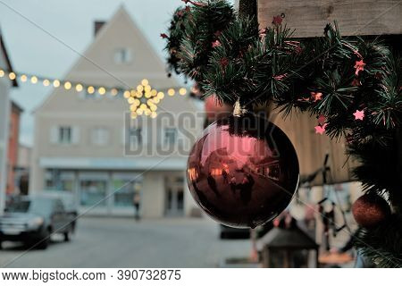 Christmas And New Year In Europe.winter Christmas Holidays. Street Festive Decor.christmas Red Ball