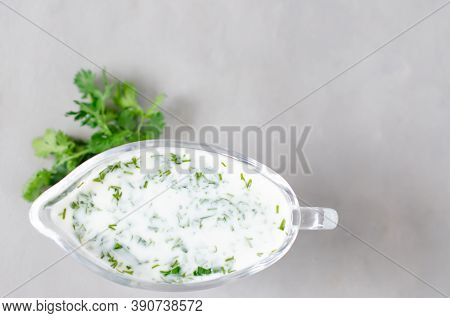 White Sauce With In A Gravy Boat On A White Background. Flat Lay.