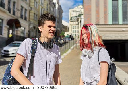 Portrait Of Talking Students Teenagers Boy And Girl 16, 17 Years Old In The City. High School And Co
