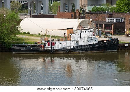 Tugboat Moored On A River