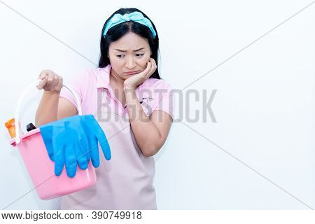 Asian Middle Aged Housewife Standing Holding Plastic Buckets And Cleaning Equipment, Showing Wearine