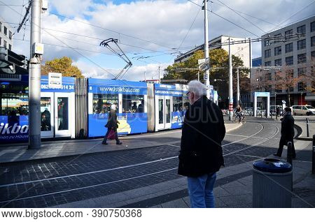 German People And Foreigner Travelers Walking And Waiting Tramway And Bus Go To Destination At Front
