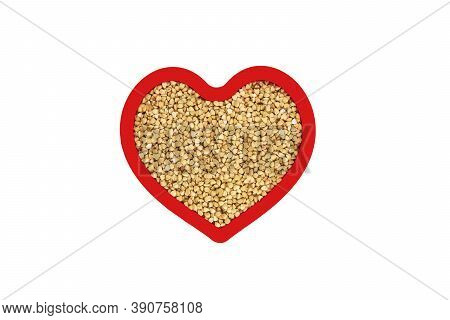 Green Buckwheat Groats In Heart Shape Red Frame Isolated On White Background