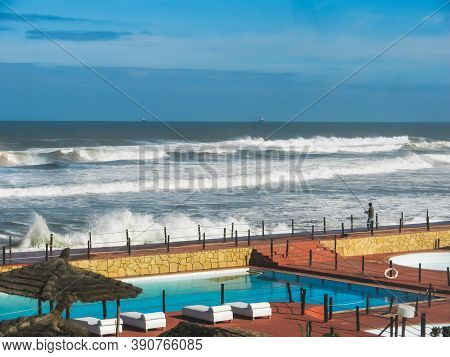 View Of The Atlantic Ocean With Waves In Casablanca, Morocco. Fisherman At The Coast. Leisure Activi
