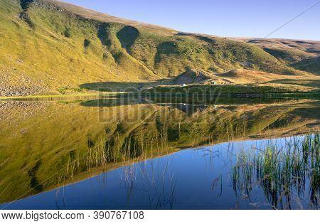 Morning landscape on mountain lake in Carpathians, Ukraine