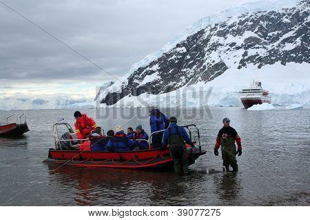 Zodiac Boats Ferry Passengers To Shore