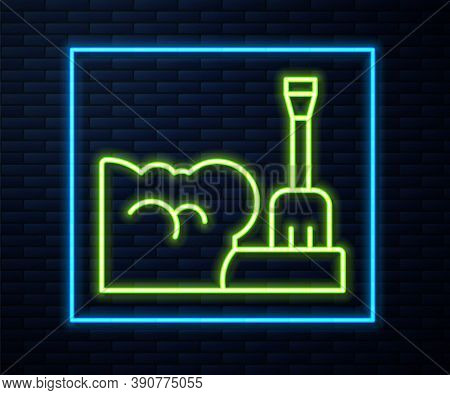 Glowing Neon Line Shovel In Snowdrift Icon Isolated On Brick Wall Background. Vector