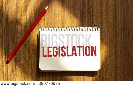 Red Pen And Notepad With Text Legislation In The White Background