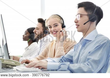 Telemarketing Concept. Happy Hotline Operators Selling Goods Or Services Through Voip Telephony At C