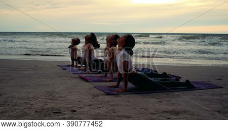 Group Females Yoga Practice In Class On Mat Stretching Relaxation Exercise With Pose Fitness Sport F