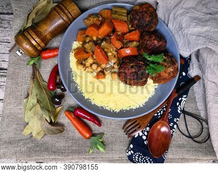 Kofta Tagine Moroccan Meatballs Served With Semolina and Vegetables