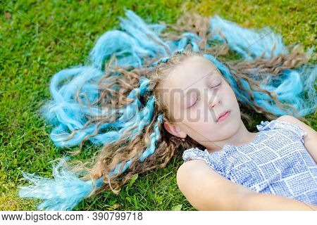 The Girl On The Lawn. Rest In Nature. Sleeping On The Meadow, To Dream. Stroking The Grass. Relaxati
