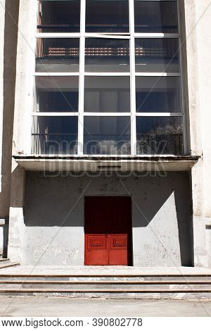 Vintage Old Wooden Door Of Concrete Building With White Walls, Marble Steps, Sharp Shadows. Rusty Ag