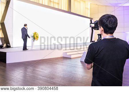 Baku / Azerbaijan - 03-12-2020: Man Recording A Speaker With White Wall Screen For Presentation