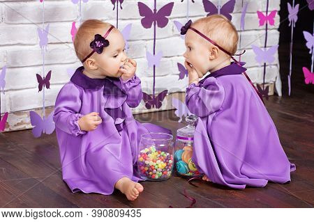 One-year-old Twins On The Birthday. Cute Twin Sisters Celebrating Their 1Th Birthday. Little Twins G