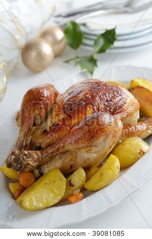Roasted turkey with vegetables on a Christmas table