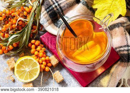 Healthy Autumn Vitamin Drink. Hot Sea Buckthorn Tea With Lemon With Fresh Sea Buckthorn Berries On A
