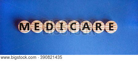 Wooden Circles With Word 'medicare'. Beautiful Blue Background. Medical Concept. Copy Space.