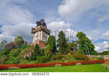 The Famous Clock Tower And Gardens On Schlossberg Hill, Tourist Attraction In Graz, Styria Region, A