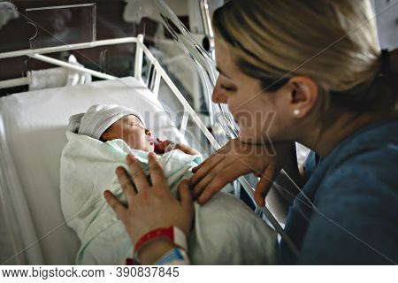 Mother With Her Newborn Baby At The Hospital A Day After A Natural Birth Labor