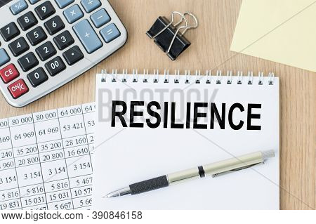 Resilience Words On An Open Notebook On An Office Desk. Business Concept