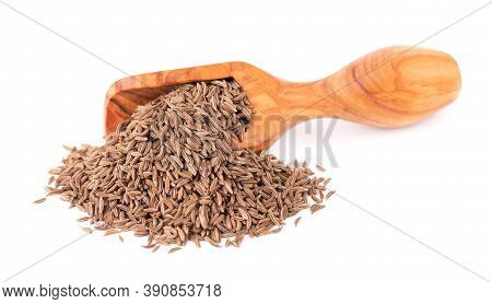 Cumin Seeds In Wooden Scoop, Isolated On White Background. Cumin Seeds Or Caraway.