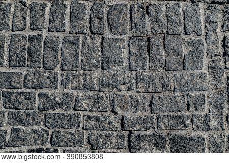 Old Paving Stone Mosaic Pattern. Pavement Texture. Gray Cobblestone Sidewalk Background. Rough Grani