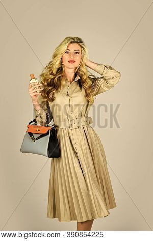 Attractive Woman Hold Perfume Bottle. Owner Of Fragrance Is Young Modern Lady Who Keeps Up To Date.