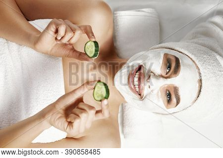 Beautiful Woman With Clay Facial Mask In Beauty Spa. Skin Care. Beauty Concept. Facial Treatment. Co