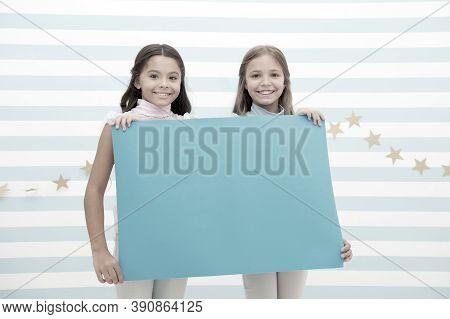 Kids Announcement Concept. Amazing Surprising News. Girl Hold Announcement Banner. Girls Kids Holdin