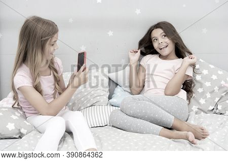 Girlish Leisure Pajama Party. Girls Smartphone Posing Great Shot. Send Photo Social Network Using Sm