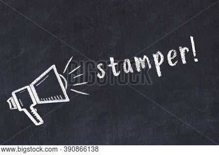 Chalk Drawing Of Loudspeaker And Handwritten Inscription Stamper On Black Desk